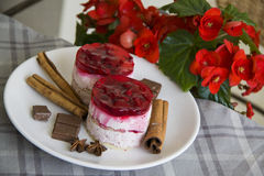 Raspberry cakes with red flowers background Royalty Free Stock Photos