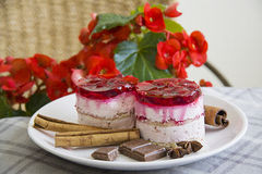 Raspberry cakes with red flowers background Royalty Free Stock Photo