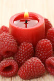 Raspberry candle Stock Photography