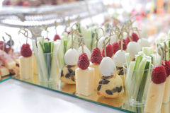 Raspberry, cheese, cucumber and eggs canapes Royalty Free Stock Images
