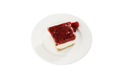 Raspberry cheesecake. On white plate Royalty Free Stock Images