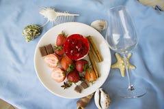 Raspberry cheesecake on blue marine background Royalty Free Stock Images