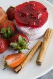 Raspberry cheesecake with cinnamon sticks Stock Photo