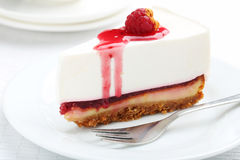 Raspberry cheesecake. Fresh raspberry cheesecake on white plate Stock Photo