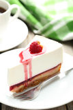 Raspberry cheesecake. Fresh raspberry cheesecake on white plate Royalty Free Stock Photos