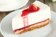 Raspberry cheesecake. Fresh raspberry cheesecake on white plate Stock Image