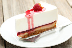 Raspberry cheesecake. Fresh raspberry cheesecake on white plate Royalty Free Stock Photo