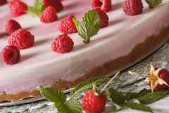 Raspberry cheesecake with mint macro on the table. Horizontal. Raspberry cheesecake with mint macro on the plate. Horizontal Royalty Free Stock Photos