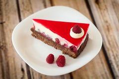 Raspberry cheesecake. Piece of raspberry cheesecake on white plate Royalty Free Stock Image