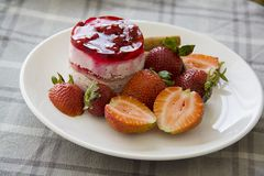 Raspberry cheesecake on plate Royalty Free Stock Images
