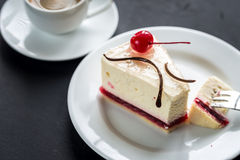 Raspberry cheesecake with sweet cherry Royalty Free Stock Image