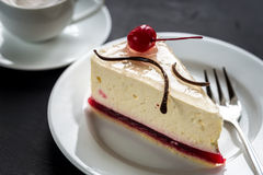 Raspberry cheesecake with sweet cherry Royalty Free Stock Photography