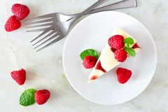 Raspberry cheesecake top view over a bright background Stock Images