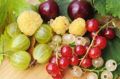 Fruits. Raspberry, cherry, currant, on wooden ground Royalty Free Stock Photography