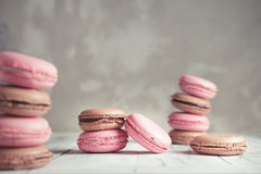 Raspberry and Chocolate pastel colored Macarons or Macaroons Royalty Free Stock Image