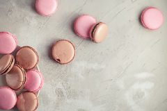 Raspberry and Chocolate pastel colored Macarons or Macaroons Stock Photos