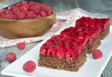 Raspberry chocolate pie with nuts Stock Photos
