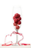 Raspberry chocolate truffles in a champagne glass Royalty Free Stock Photos
