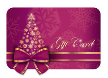 Raspberry Christmas gift card with purple ribbon a Royalty Free Stock Photo