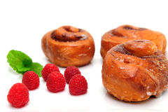 Raspberry and Cinnamon Rolls Royalty Free Stock Photography