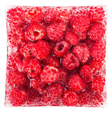 Raspberry close-up in ice cube. Natural ripe raspberry close-up in ice cube Stock Photography