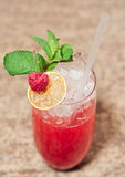Raspberry cocktail. With mint in highball glass Stock Photography