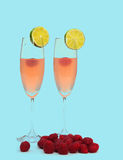 Raspberry cocktail on blue Stock Image