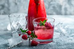 Raspberry cocktail, fizz, lemonade, ice tea with fresh mint on blue wooden background. Close up. Raspberry cocktail, fizz, lemonade, ice tea with fresh mint on royalty free stock photography
