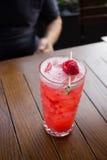 Raspberry Cocktail. On the patio Stock Photos