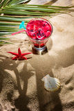 Raspberry cocktail on the sand Royalty Free Stock Image