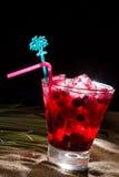 Raspberry cocktail on the sand Stock Photos