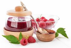 Raspberry confiture in can with fresh berries royalty free stock image