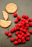 Raspberry and cookies. Healthy eating, food, dieting - oat cookies with  fresh raspberry soft cheese on black slate Stock Photo