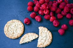 Raspberry and cookies. Healthy eating, food, dieting - oat cookies with  fresh raspberry soft cheese on black slate Stock Photography