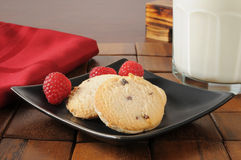 Raspberry cookies and milk Royalty Free Stock Images