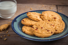 Raspberry cookies on plate and milk glass. Raspberry cookies on plate and glass of milk Stock Photo