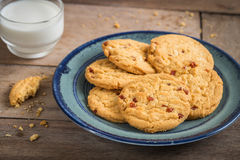 Raspberry cookies on plate and milk glass. Raspberry cookies on a plate and milk glass Stock Images