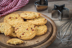 Raspberry cookies on wooden plate Royalty Free Stock Photo