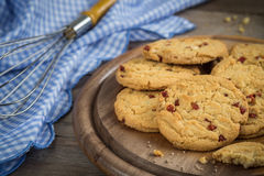 Raspberry cookies on wooden plate Stock Photos