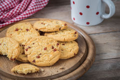 Raspberry cookies on wooden plate and coffee cup Royalty Free Stock Photography