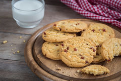 Raspberry cookies on wooden plate and milk glass. Raspberry cookies on a wooden plate and milk glass Stock Photography