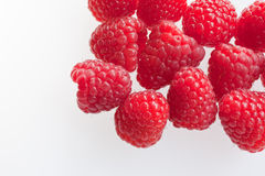 Raspberry Corner. A selection of raspberriesagainst a white background Stock Images