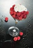 Raspberry And Cream. Glass with raspberries and cream stock photo