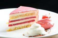 Raspberry cream cake. With ice cream Stock Photo