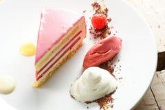 Raspberry cream cake. With ice cream Royalty Free Stock Image