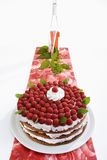 Raspberry cream cake on table runner and raspberry wine royalty free stock photo