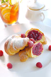 Raspberry croissant. Delicious breakfast - fresh raspberry croissant Stock Photo