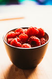 Raspberry in a cup on  background of wooden boards Royalty Free Stock Photos
