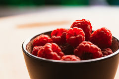 Raspberry in a cup on background of wooden boards Stock Photography