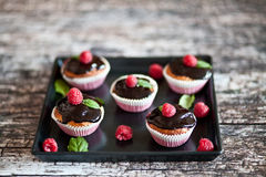Raspberry cupcakes. Raspberry cupcake mint fruit sweetness Royalty Free Stock Image